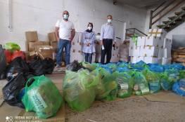 """تنمية بيت لحم و """"ملتمين عالخير"""" يوزعان 108 طرود غذائية على الأسر المحتاجة"""