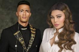 جدل حول الاستعانة بهيفاء وهبي ومحمد رمضان للترويج للسياحة واللباس التقليدي في الجزائر ..فيديو