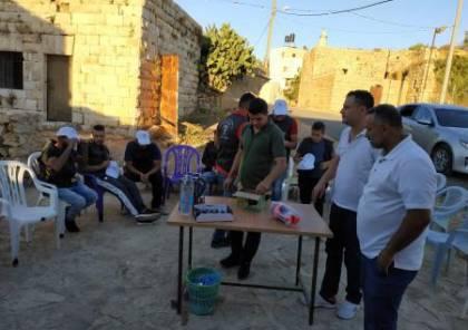 توزيع تجهيزات حراسة على القرى المحاذية للمستوطنات في محافظة سلفيت