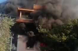 أجواء مشحونة وحرق منزل بعد مقتل شاب وإصابة اثنين في الـ48