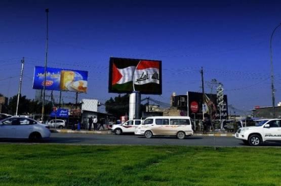 العلم الفلسطيني بدلا من الأردني في شوارع بغداد ترحيبا بالملك عبد الله