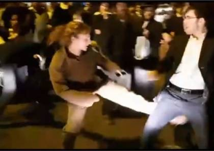 """فيديو: هكذا ردت مجندة اسرائيلية على متدينيين وصفوها """"بالعاهرة""""و هاجموها"""