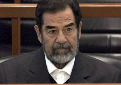 """صورة كبيرة """"مهينة"""" لصدام حسين في مجلس عزاء القاضي الذي حاكمه.. صور"""