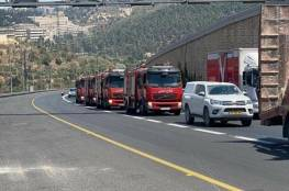 الدفاع المدني الفلسطيني يشارك باطفاء الحرائق في القدس.. واسرائيل تعقب