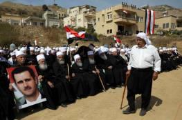 خط التماس مع إسرائيل في الجولان يلتهب بهتافات مؤيدة للأسد