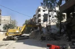 بدء إزالة الانقاض من مخيم اليرموك