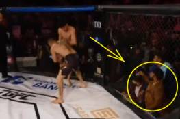 مقاتل يتعمد الخسارة تحت تهديد السلاح ...فيديو
