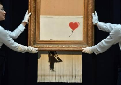 عرض لوحة بانكسي التي تمزقت تلقائيا في ألمانيا