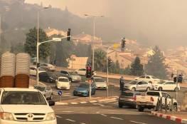 إخلاء عشرات المنازل جراء حرائق بأراضي 48