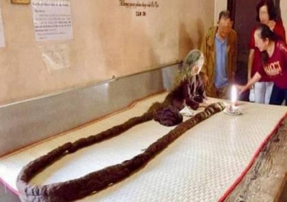 صور.. عجوز فيتنامية عمرها 83 عاما وطول شعرها 6 أمتار