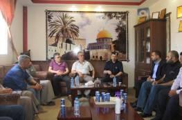 """صور.. اجتماع بين الشرطة و""""الشعبية"""" بشأن حادثة الاعتداء على """"أم جبر وشاح"""""""