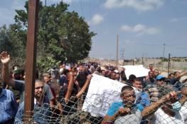 تجار وعمال غزة يطالبون بفتح المعابر ورفع الحصار