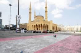 فنان يرسم بالطبشور أكبر علم لبناني لدخول موسوعة غينيس