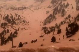صور وفيديو: رمال الصحراء الكبرى تغطي ثلوج أوروبا