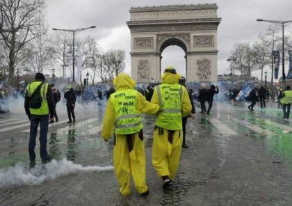 """فرنسا: متظاهرون يلوّحون بالأعلام الفلسطينية في مظاهرة """"السترات الصفراء"""""""