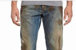 جينز متسخ وملطخ بالوحل يباع بسعر باهظ !