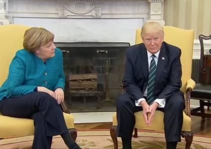 """البيت الأبيض يوضح قصة """"المصافحة"""" بين ترامب وميركل"""