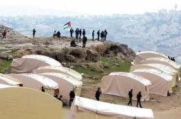 """نشطاء يقيمون قرية """"باب الشمس"""" قرب """"معالي ادوميم""""والاحتلال يحاصرها"""