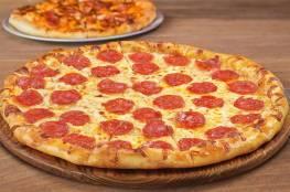 """بريطانيا تكافح البدانة بإجراء """"غريب"""" ضد البيتزا"""